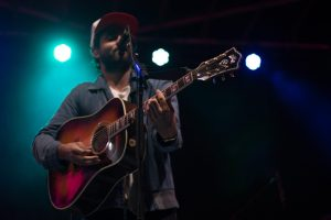 Johnathon Russell of THATH on stage. Photo courtesy of Chapman Croskell of The Rocky Mountain Collegian.
